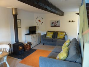 Mardon living room comfy sofas and woodburner